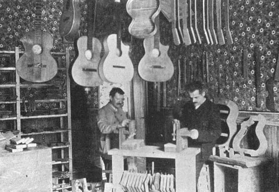 Mozzani's                         shop, 1906, with cutaway guitars!