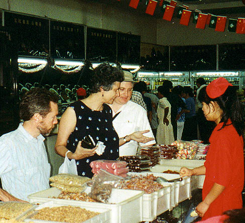Heath, Suzanne and Jody admiring; Suzanne bought pickled peanuts for a cab-ride snack. YUM!