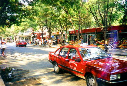 shopping street near the hotel;                 note the ubiquitous red Xiali taxis